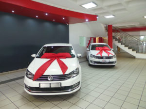 CARS WITH RED BOW